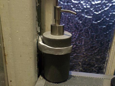 Pump bottle holder